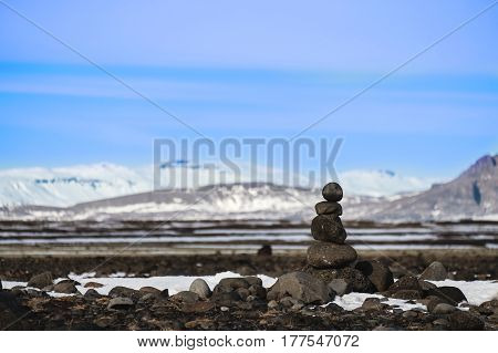 Stone stacked balanced with winter landscape backgrounds