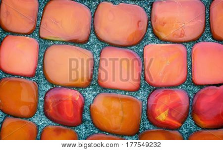 Background image: a fragment of the surface beautiful decorated with red ceramic tiles oval.