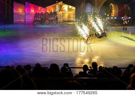 In the ice Palace the audience watching the performance of a skater on a spinning wheel with fireworks.