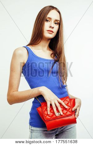 young pretty long hair woman happy smiling isolated on white background, wearing cute tiny fashion handbag, lifestyle people concept