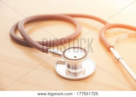 Stethoscope on wooden background for medical or science concept
