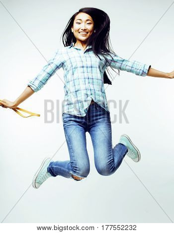 young pretty jumping asian woman posing cheerful emotional isolated on white background, lifestyle people concept close up