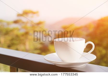 Cup Of Hot Cappuccino Coffee On Nature Background. Toned Image