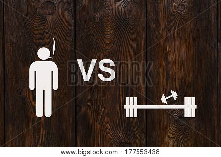 Man with cigarette and dumbbells. Sport or quit smoking concept. Abstract conceptual image