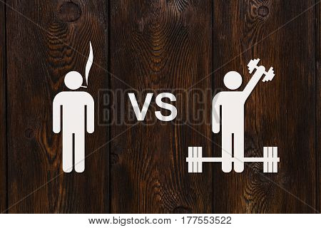 Man with cigarette vs dumbbells. Sport or quit smoking concept. Abstract conceptual image