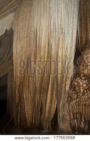cave stalagmites formations wall geology underground  tourist