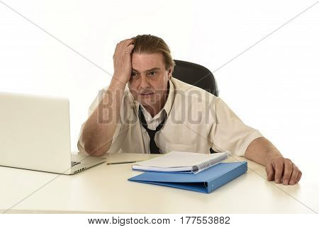sad and stressed businessman on his 40s with loose tie and messy look gesturing desperate overworked and overwhelmed in busy tired and exhausted office work and business stress