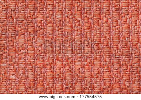 Bright orange knitted woolen background with a pattern of soft fleecy cloth. Texture of ginger textile closeup.