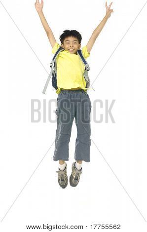 child jumping with backpack, back to school