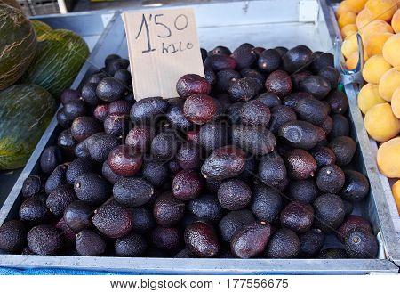 Delicious purple avocado on Sunday market in Spain, Mercadillo de Campo de Guardamar