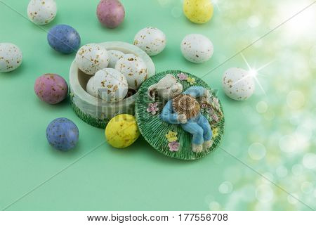Easter egg background - bunny sleeping in meadow with speckled eggs