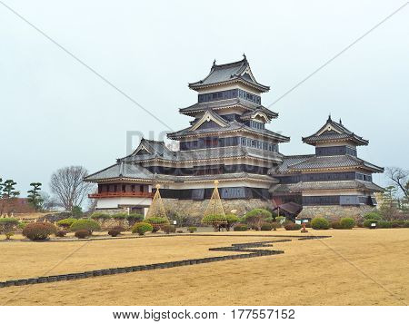 Matsumoto Castle is a Japanese castle in rainy day at Matsumoto, Nagano, Japan. The building is also known as the Crow Castle due to its black exterior, It is listed as a National Treasure of Japan.
