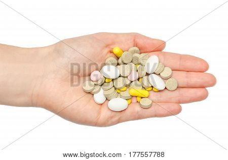 Hand Of Young Girl Holding Pills.