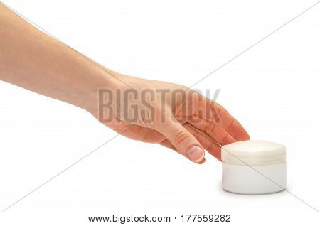 Hand Of Young Girl Holding Cream Bottle.