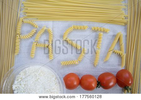 pasta at the fresh tomato in a plays of written with the presence of the ingredients