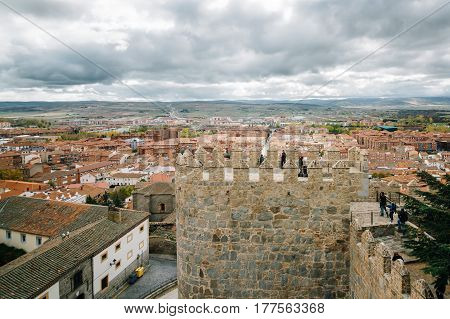 Avila Spain - November 11 2014: Cityscape of Avila from Medieval Walls a cloudy day. The old city and its extramural churches were declared a World Heritage site by UNESCO