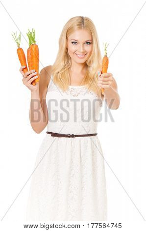 Half-length portrait of very beautiful woman holding fresh carrots and looking at us. Studio shot isolated on white background. Healthy eating concept.