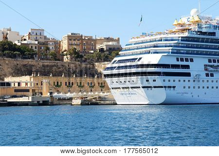 VALLETTA MALTA - APRIL 22: The Costa Fascinosa cruise ship with tourists is in harbour on April 22 2015 in Valletta Malta. More then 16 mln tourists is expected to visit Malta in year 2015.