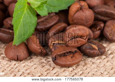 coffee beans on sackcloth close up macro.