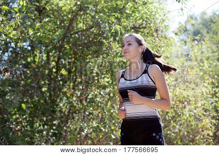 girl goes in for sports runs in the forest