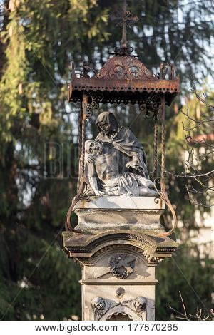 SWOSZOWICE POLAND - DECEMBER 11 2015: Old Wayside shrine by an unknown artist in Swoszowice near Cracow. Poland