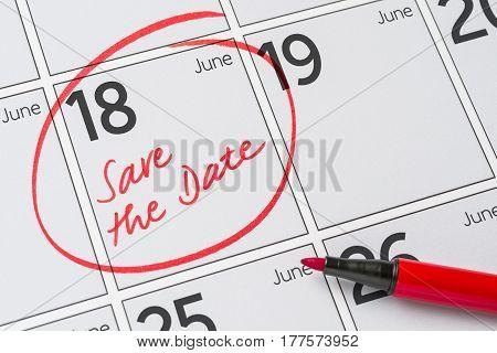 Save The Date Written On A Calendar - June 18