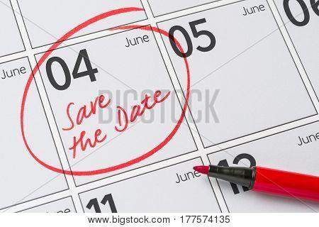 Save The Date Written On A Calendar - June 04