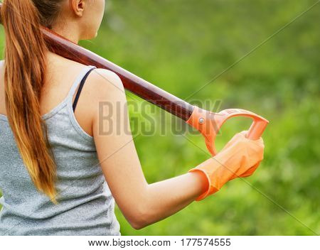 Woman Working In The Garden