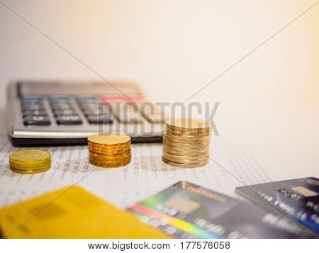 Saving Account Book from Bank for Business Finance with pen, calculator, coins, ATM and credit card.