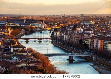Verona, Italy. Aerial view of famous touristic city Verona in Italy at sunset. Bright sky with historical buildings and river
