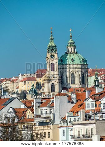 View of the Lesser Town and St. Nicholas Church in Prague, Czech Republic