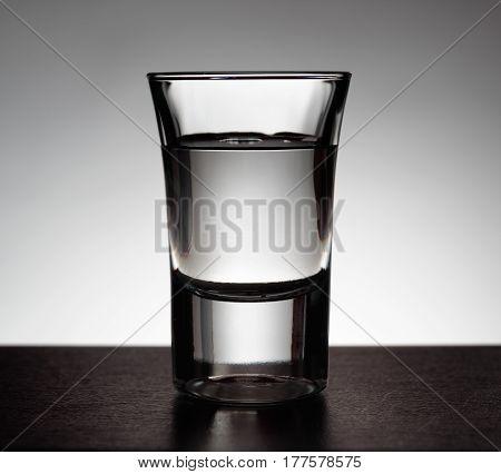 Glass Of Vodka On Grey Background