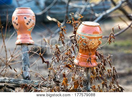 Clay pitchers on the fence, traditional Ukrainian style