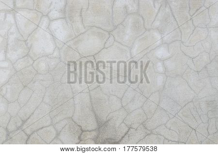 abstract of cement cracked texture on old white masonry wall. Useful as background and fantasy skin makeup as grunge background