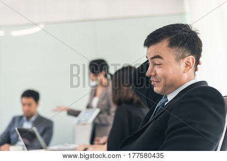 young business man feel boring at meeting