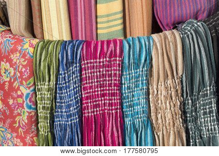 Multicoloured and different scarves. Sale. May be as background.