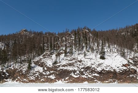 Pointed rocks in winter on the banks of the Timpton River in South Yakutia Russia