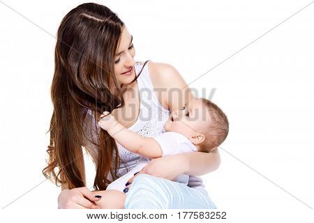 Happy mammy tenderly embracing her small baby. Family concept. Healthcare, pediatrics. Isolated over white. Copy space.