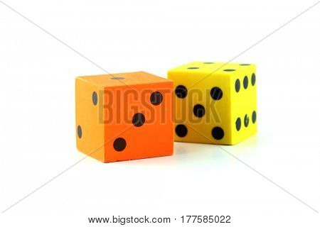 Yellow and Orange rubber dice on white background