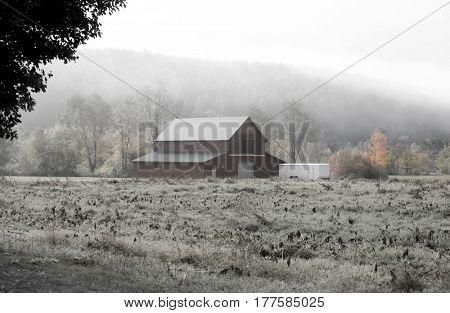 Barn caught in fog in rural Vermont