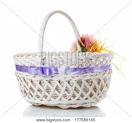 wicker basket decorated with flowers isolated on white