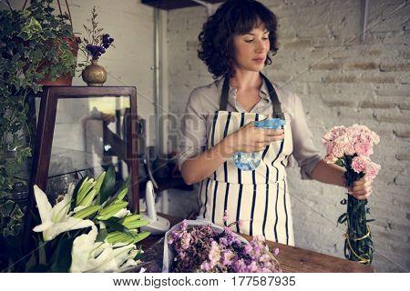 Woman Spraying Flowers to Refreshing in Flora Shop