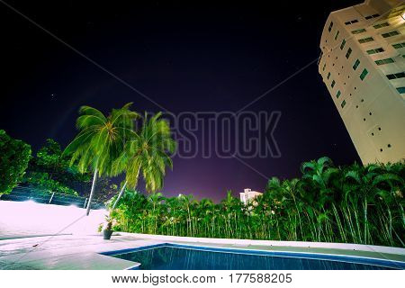 Beautiful night sky purple color in a pool