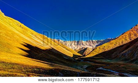 Sunset view to Tash-Rabat river and valley in Naryn province Kyrgyzstan