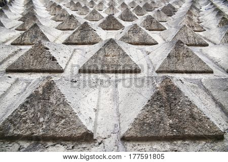 rugged pyramid texture, background wall, selective focus