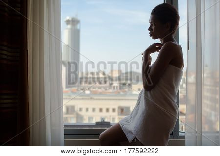 Black Woman Looking Out The Window
