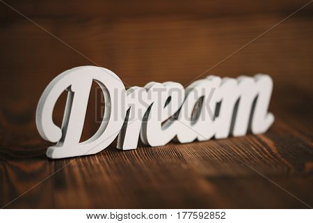 dream text on wooden background with space for text