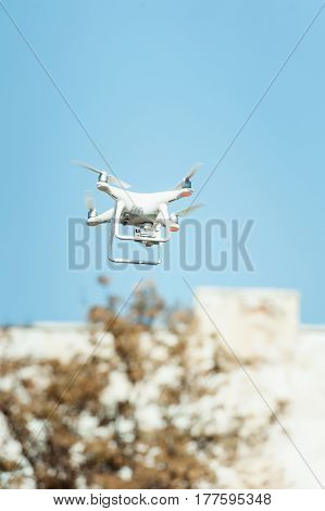 Black and white drone drone quad copter in the sky
