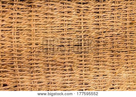 Close up of brown woven mat texture background