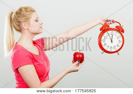 Happy Woman Holding Clock, Apple And Measuring Tape